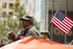 Os heróis americanos desfilam imagem de stock
