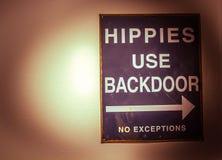 Os hippys usam para trás a porta imagens de stock