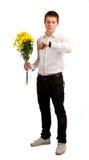 Os homens com flores Foto de Stock Royalty Free