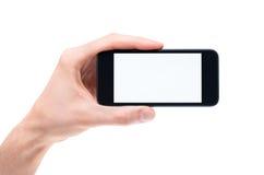 Mão que guardara o iphone vazio da maçã   imagens de stock royalty free