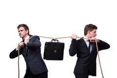 Os irmãos gêmeos no conceito do conflito isolados no branco Foto de Stock