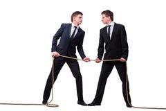 Os irmãos gêmeos no conceito do conflito isolados no branco Imagem de Stock Royalty Free