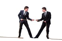 Os irmãos gêmeos no conceito do conflito isolados no branco Fotografia de Stock