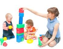 Os jogos da mulher com duas meninas Fotos de Stock Royalty Free