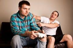 Os jogos video dos indivíduos perdem Imagem de Stock