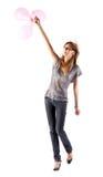 Os jovens slim a mulher com balões imagens de stock