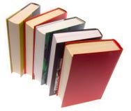 Os livros combinados por uma pilha Imagens de Stock Royalty Free
