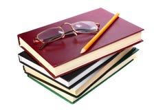 Os livros são vidros e lápis foto de stock royalty free