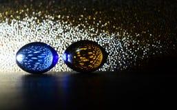 Os mármores com múltiplo coloriram a fotografia iluminada do fundo das luzes Imagens de Stock