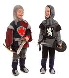 Os meninos em um cavaleiro do terno Fotografia de Stock