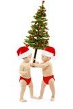 Os miúdos apresentam a árvore de abeto do Natal como o presente do ano novo Fotografia de Stock
