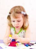 Os moldes da menina do plasticine Fotos de Stock Royalty Free