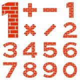 Os números ajustaram o tijolo Fotos de Stock