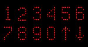 Os números de lâmpadas em um fundo preto Imagens de Stock
