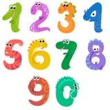 Os números gostam de dinossauros Fotos de Stock Royalty Free