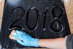 2018 os números são escritos na superfície de espuma Imagem de Stock Royalty Free