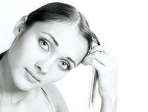 Os olhares da menina fotografia de stock