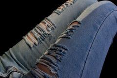 Os pés das calças de brim são modelados Imagem de Stock