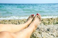 Os pés das mulheres Imagem de Stock