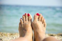 Os pés das mulheres Foto de Stock
