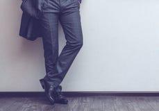 Os pés do homem de negócios Foto de Stock