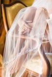 Os pés e o véu da noiva Foto de Stock Royalty Free