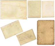 Os papéis velhos ajustaram-se isolado no fundo branco com trajeto de grampeamento Foto de Stock