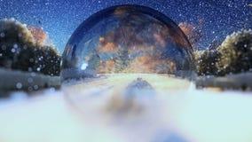 Os pares bonitos considerados através de uma esfera de vidro, nevando, zumbem para fora vídeos de arquivo
