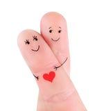 Os pares felizes abraçam o conceito, pintado nos dedos imagens de stock