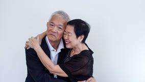 Os pares idosos asiáticos do sorriso feliz no negócio attire, proprietário do SME fotos de stock