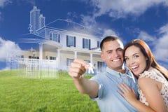 Os pares militares que guardam chaves da casa com o desenho da casa de Ghosted sejam Imagem de Stock Royalty Free