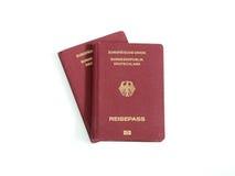 Os passaportes alemães isolaram o fundo branco Foto de Stock Royalty Free