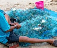 Os pescadores estão vivendo no litoral imagens de stock royalty free