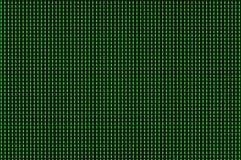 Os pixéis verdes iluminaram-se acima em um monitor do computador fotos de stock