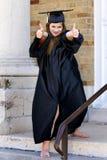 Os polegares levantam o graduado fotos de stock royalty free
