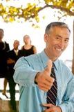 Os polegares levantam o homem de negócio Imagens de Stock Royalty Free
