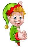 Os polegares levantam o personagem de banda desenhada do duende do Natal Fotos de Stock Royalty Free
