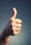 Os polegares levantam o símbolo Imagem de Stock