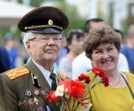 Os povos durante a celebração de Victory Day estão na exposição de realizações econômicas Fotos de Stock