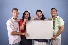 Os povos felizes com bandeira dão os polegares acima Fotografia de Stock