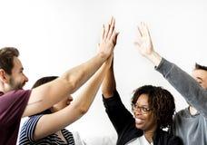 Os povos juntados entregam junto em equipe Imagens de Stock Royalty Free