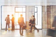 Os povos no escritório moderno incitam, vidro, tonificado Fotos de Stock Royalty Free