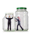 Os povos prendidos no frasco de vidro Imagens de Stock Royalty Free