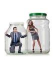 Os povos prendidos no frasco de vidro Foto de Stock