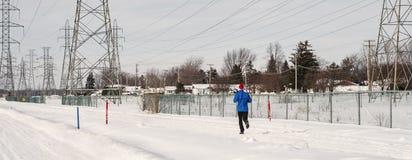 Os povos que movimentam-se em um carro de neve arrastam em Laval Fotografia de Stock Royalty Free