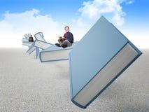 Povos no livro Imagem de Stock