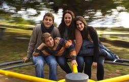 Os primos em um alegre vão círculo Imagem de Stock Royalty Free