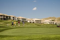 Os ricos golfing Fotos de Stock