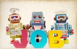 Os robôs dos trabalhos tonificaram a imagem imagem de stock royalty free