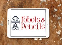 Os robôs e os lápis firmam o logotipo Fotografia de Stock Royalty Free